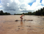 Naked man braves crocodile-infested waters for bet Featured Image
