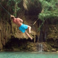 Laos luang prabang kuang si falls rope swing