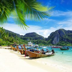 Thai boats on shore