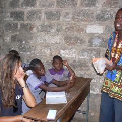 Sara assists the teacher in class at the olives centre
