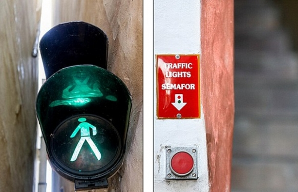 Thin Prague street has people traffic lights Featured Image