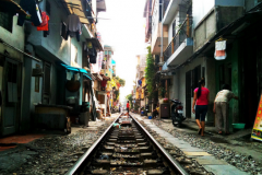 Train squeezes through Hanoi Featured Image