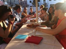 Having supper in the evening sunshine, Florence