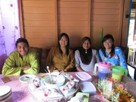 Having a meal with the villagers during Aidilfitri