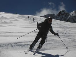 Feel the freedom of skiing down vast, untracked areas of sunny mountainside
